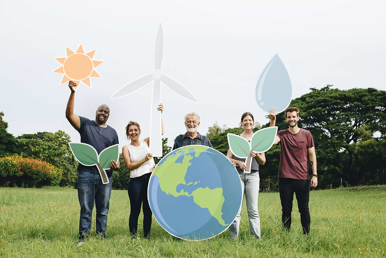 People holding symbols of renewable energy